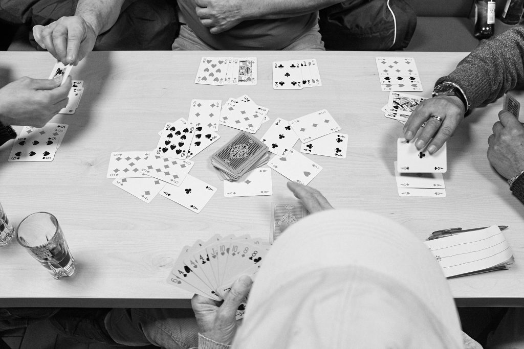 Hands of men playing rummy. Duesseldorf, Germany, 2018.