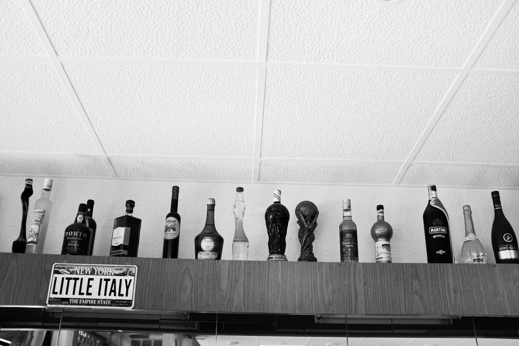 Bottles lined up on the top of the counter. Duesseldorf, Germany, 2018.