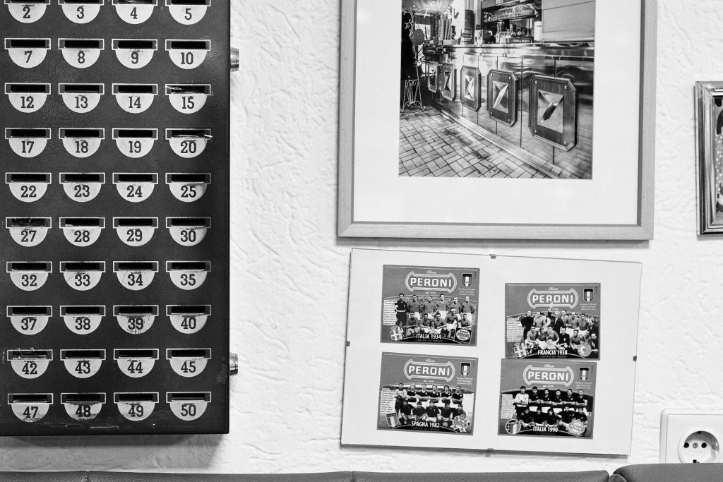 Some old photos and postcards of the Italian football team hang on the wall. Duesseldorf, Germany, 2018.